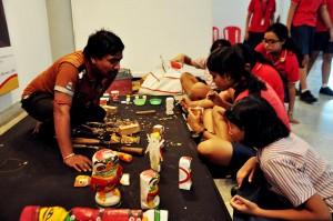 Wooden Doll artist in a workshop