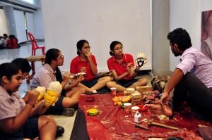 Wooden Mask artist in a workshop